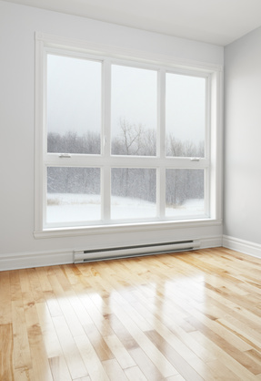 Empty room and winter landscape seen through the window