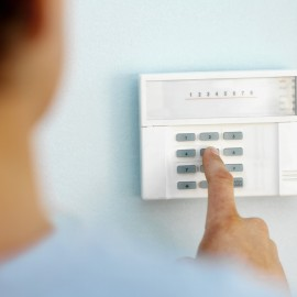 Man putting in alarm code
